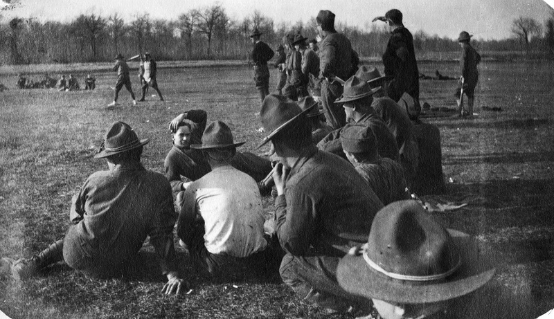 Soldiers relaxing in field during baseball game at U.S. Army Base Hospital 18