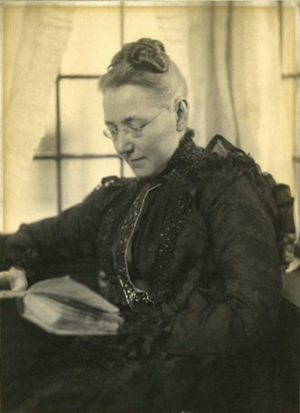 Mary Elizabeth Garrett reading a book, portrait photograph circa 1910