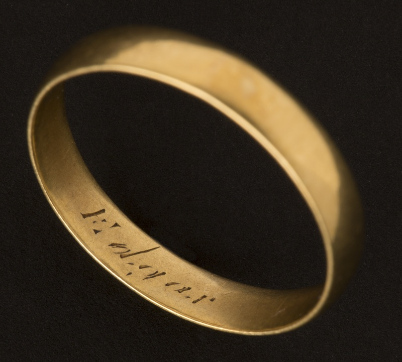 "Gold engagement ring engraved with ""Edgar"""