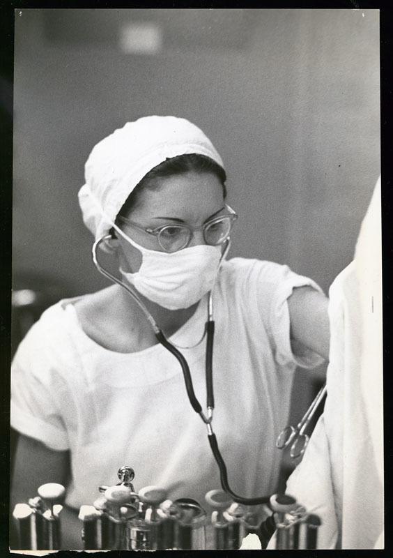 Nurse anesthetist in surgery, 1952