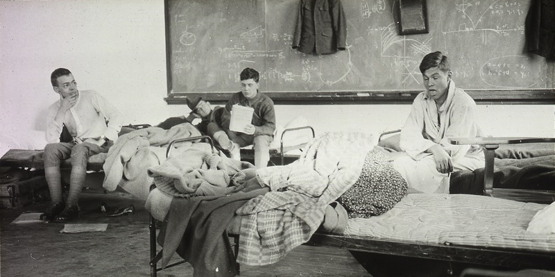 Student Army Training Corps students sitting on beds in barracks