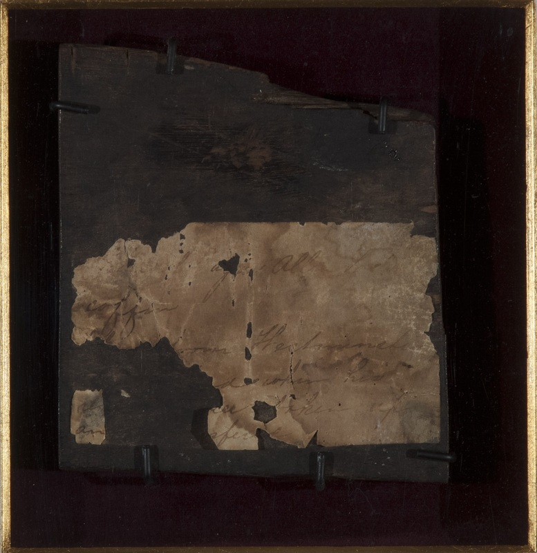 Fragment of Poe's coffin, with receipt, retrieved when his remains were relocated in 1875.
