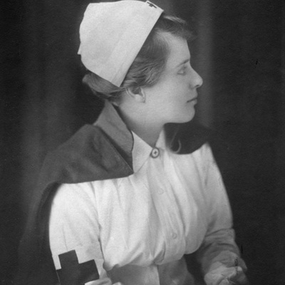 Katherine Olmsted, portrait photograph, wearing Red Cross uniform
