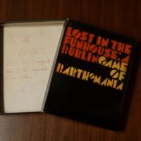 "Board game box, ""Lost in the Funhouse: A Burlingame of Barthomania"""
